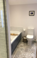 Bathroom with patterned tiled floor