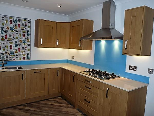 Oak kitchen, silestone worktops, bespoke painted glass