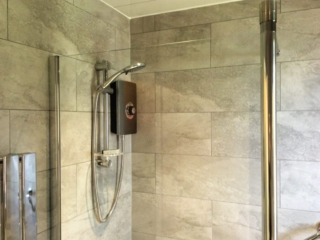 Electric shower, fully tiled