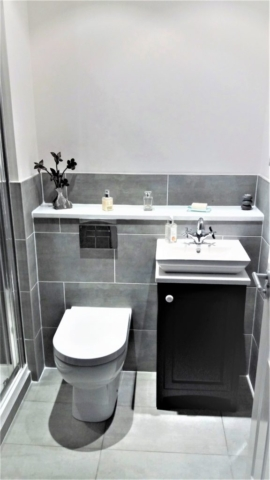 Utopia cabinet, basin, concealed cistern and half height tiling